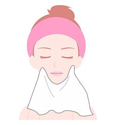 顔を拭いてる女性の画像